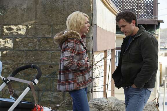 """This image released by Roadside Attractions and Amazon Studios shows Michelle Williams, left, and Casey Affleck in a scene from """"Manchester By The Sea."""" (Claire Folger/Roadside Attractions and Amazon Studios via AP)"""