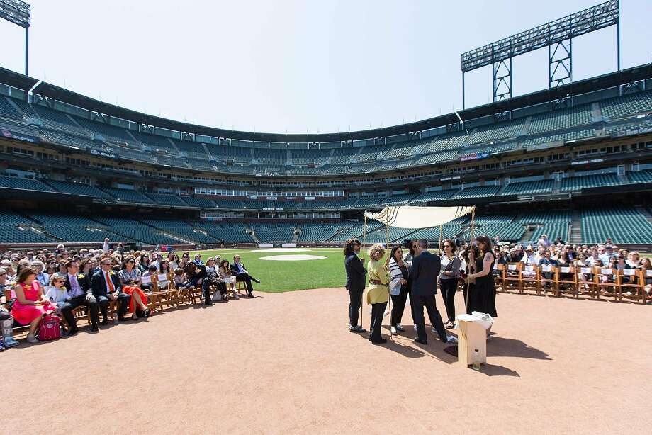 Sunny Schwartz and Lauren Obstbaum married May 29 at AT&T Park in a ceremony officiated by Rabbi Michael Lezak. A chuppah (Jewish wedding canopy) was placed at second base so as not to disturb the grass. Photo: Bustle & Twine