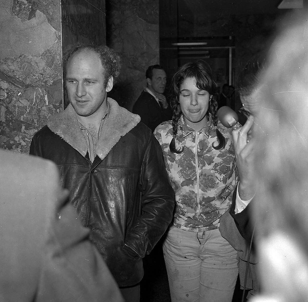 """MOUNTAIN GIRL: Carolyn Adams had a child with Ken Kesey and later married Jerry Garcia. She was known as """"Mountain Girl"""" and was a major personality during the Summer of Love, no doubt helped by being a major figure in Tom Wolfe's stories about the acid tests. Here she is with Kesey after they got busted for pot in 1966."""