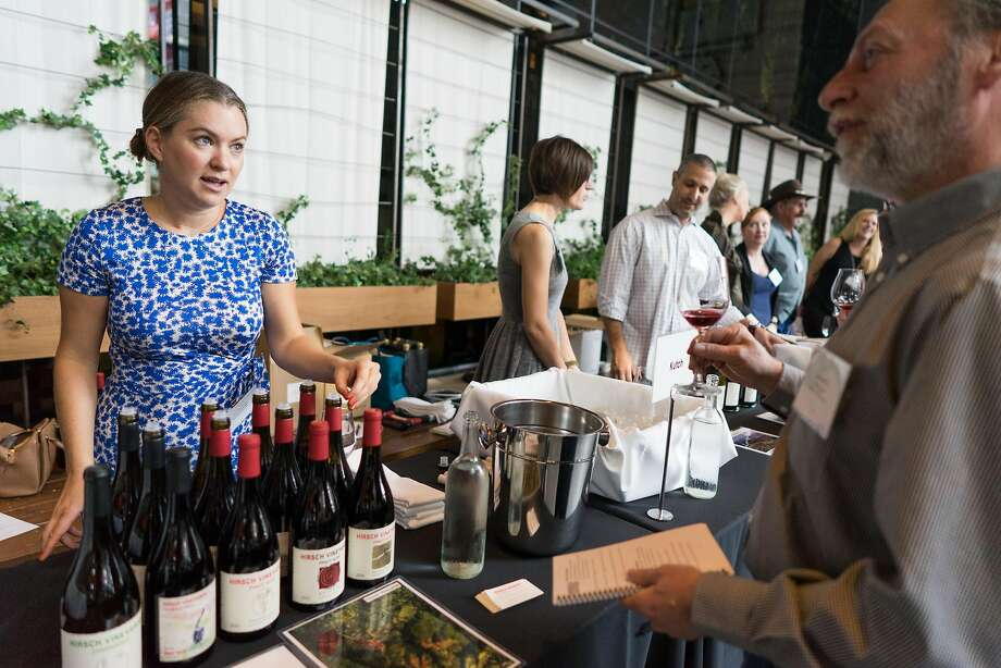 Jasmine Hirsch, left, presents her Hirsch Vineyards Pinot Noirs and Chardonnays to Brian Goehry at the final In Pursuit of Balance event. Photo: James Tensuan, Special To The Chronicle