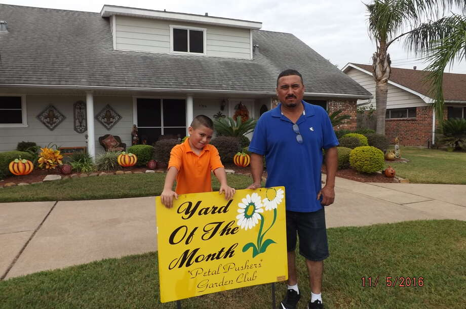Ramiro Morales and his son, Ramiro, received the title of Yard of the Month for November from the Petal Pushers Garden Club of Deer Park. The family's yard, located at 1306 Luella Avenue in Deer Park, features a pumpkin décor in time for Thanksgiving.