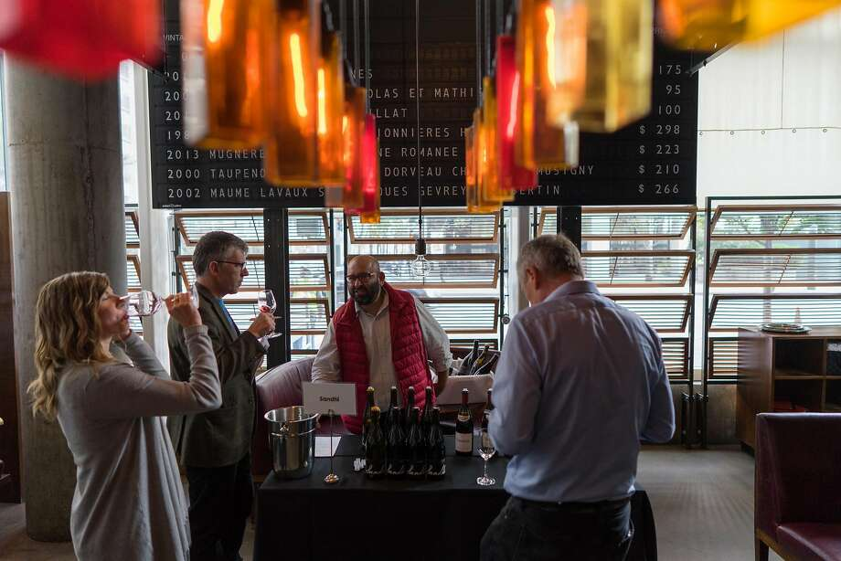 Raj Parr, second from right, presents his wine to guests at the In Pursuit of Balance event. Photo: James Tensuan, Special To The Chronicle