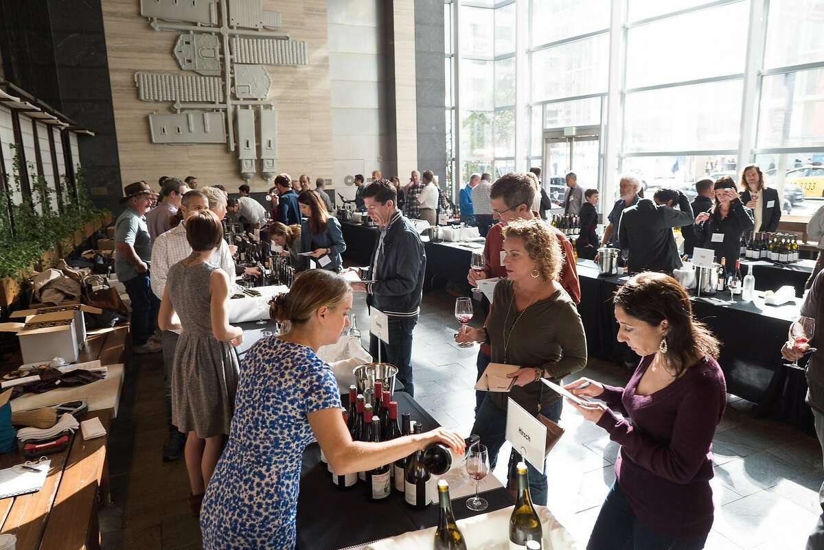 People sample wines at an In Pursuit of Balance event at the Millennium Tower in San Francisco, Calif. on Monday, Nov. 14, 2016. This was the last wine tasting event put on by In Pursuit of Balance.