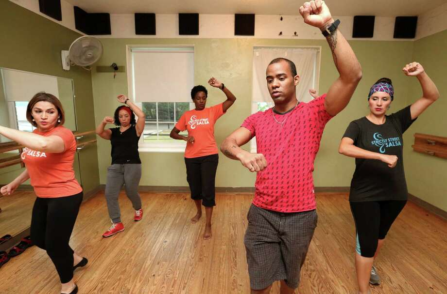 At Strictly Street Salsa, instructor Rey Salsa teaches Afro-Latino dancers a new Orisha Shango-style dance. Photo: Yi-Chin Lee, Houston Chronicle / © 2016  Houston Chronicle