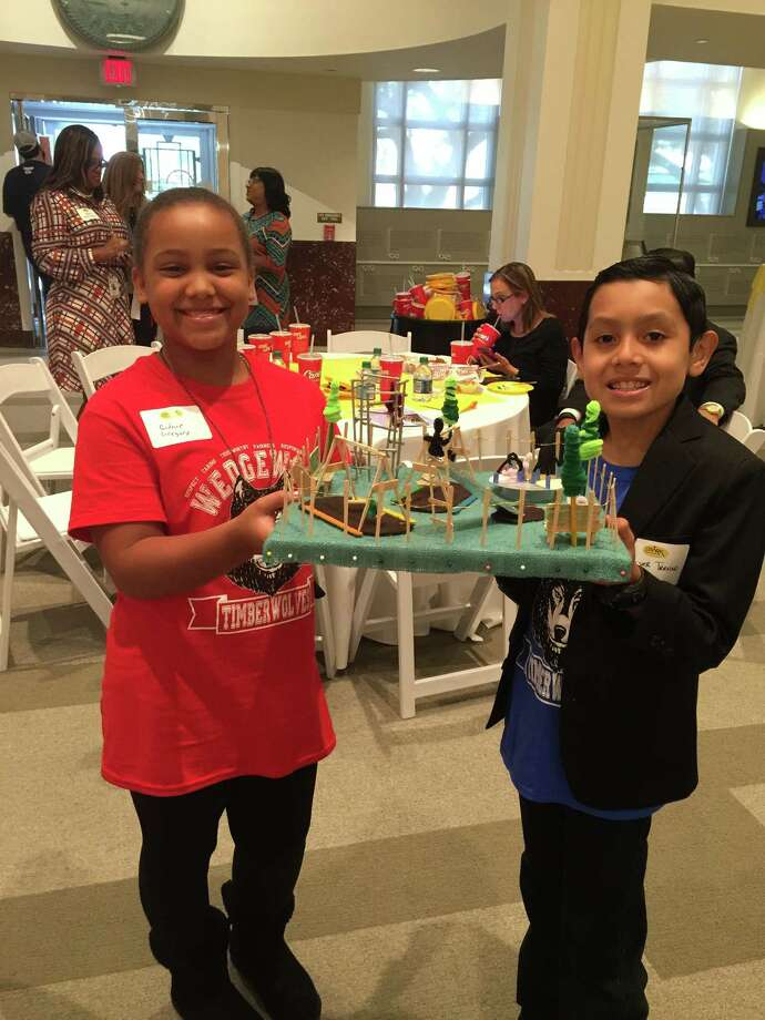 Wedgewood Elementary School fifth-grade pupil Cidnie Gregory and fourth-grade pupil Conner Trevino present a model of the planned SPARK Park to be developed at the campus.