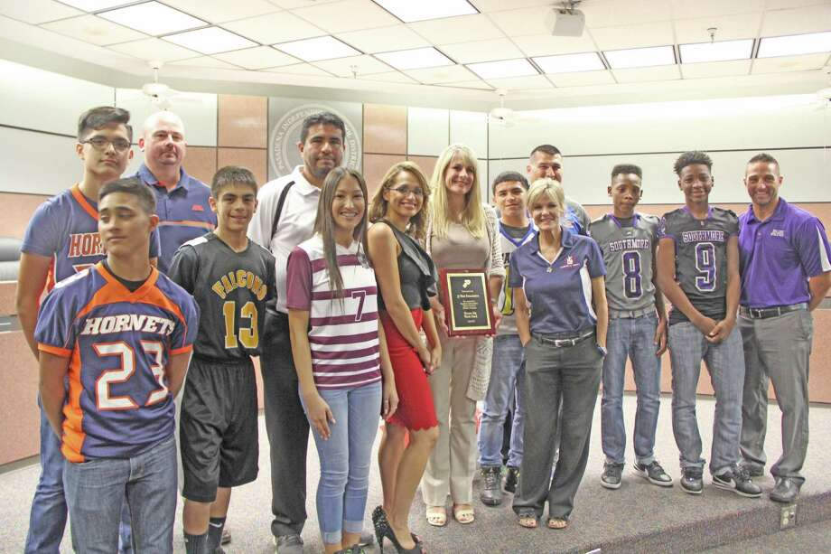 A group of Pasadena ISD students and coaches from South Houston, Jackson, Queens, Miller and Southmore intermediate schools recognized Connie Watt, vice president of the Justin J. Watt Foundation, center, for the foundation's support for after-school programs over two years. The group has donated $148,855 in that effort.