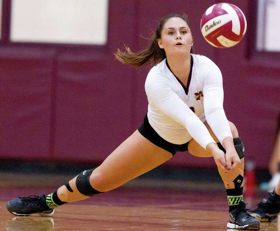 Magnolia West libero Nicole Grant (2) returns a serve during the second set of a District 20-5A high school volleyball game at Magnolia West High School Friday, Oct. 14, 2016, in Magnolia. Photo: Jason Fochtman, Staff Photographer / Houston Chronicle