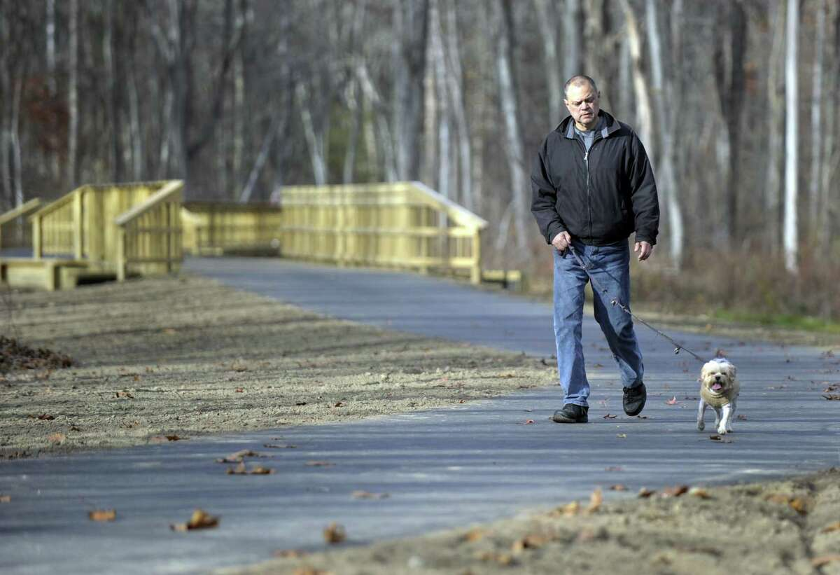 Bob Lehner of Brookfield walks his dog at the Still River Greenway Monday, Nov. 14, 2016, a place he visits several times a week. Still River Greenway, a nearly two-mile trail that parallels Route 7 and the Still River, will soon officially open.