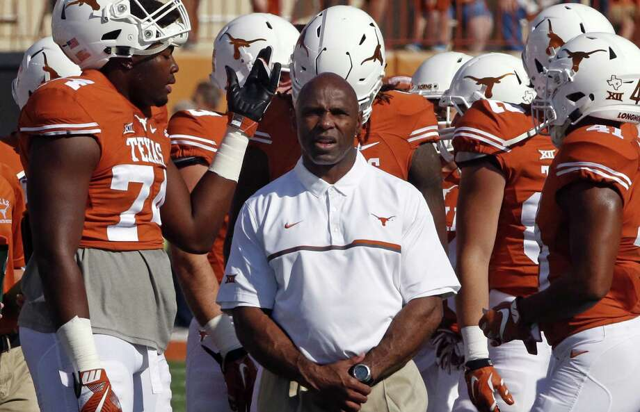 Texas coach Charlie Strong is surrounded by his players before the start of the game against West Virginia on Nov. 12, 2016, in Austin. Photo: Michael Thomas /Associated Press / FR65778 AP