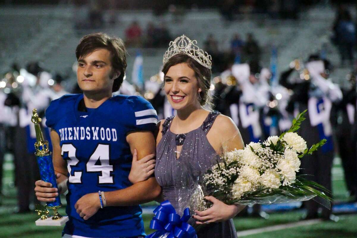 Elaina Roher escorted by Friendswood's Cody Williamson is crowned Friendswood High School Homecoming Queen during the game against Clear Lake Friday, Oct. 21 at Friendswood High School.