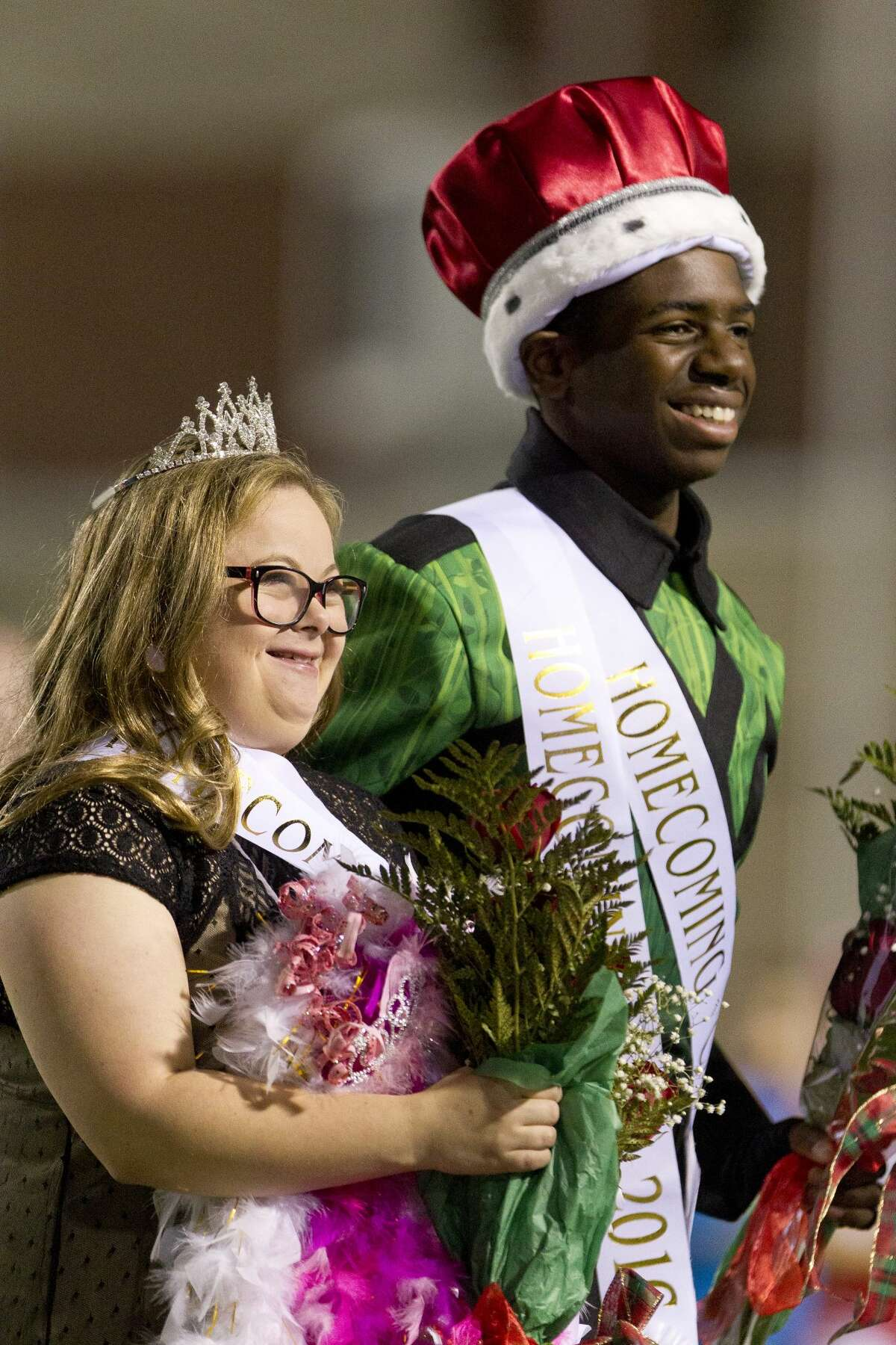Click through the slideshow to see the Houston area's homecoming royalty for 2016. Homecoming queen Hanna Pasch, left, is seen with homecoming king Shabach Khoza during halftime of The Woodlands High School's football game against Montgomery Friday, Oct. 28, 2016.