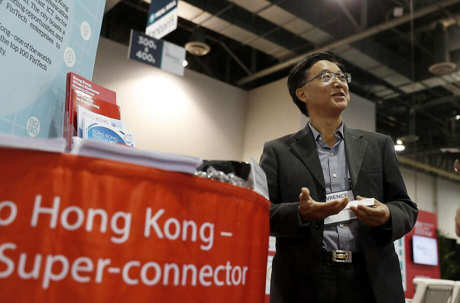 Lawrence Tang, an employee at Invest Hong Kong, works to promote Hong Kong as a fintech capital at the Money 20/20 conference in Las Vegas. Photo: ISAAC BREKKEN, NYT