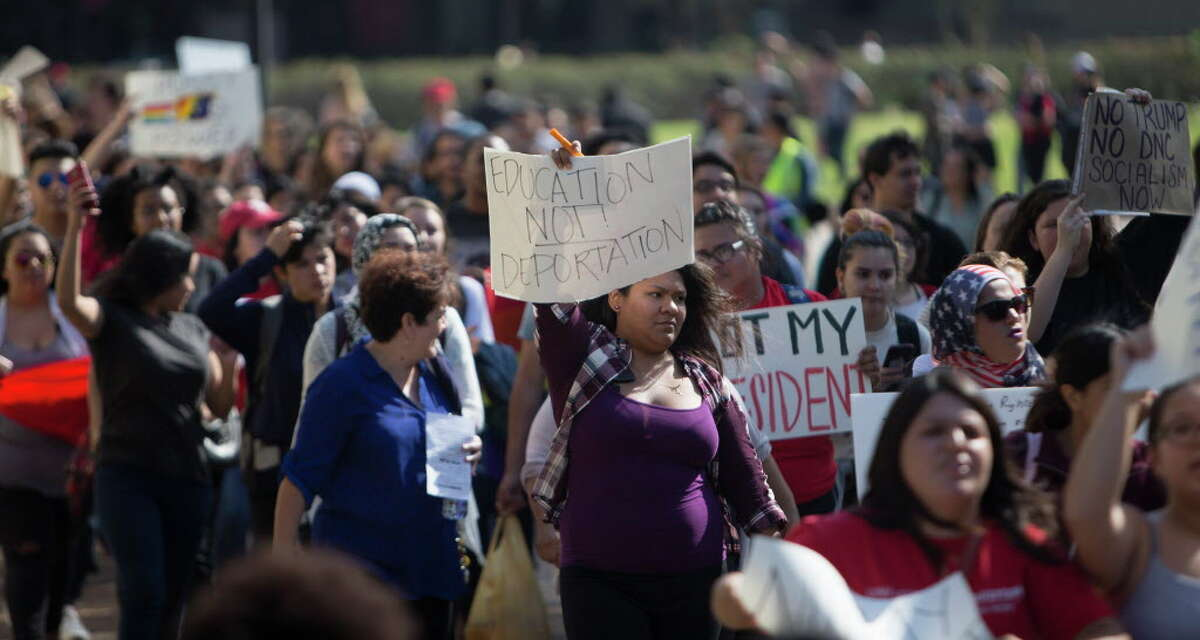Students at the University of Houston chant as they march through campus during a planned walkout and protest Monday afternoon, Nov. 14, 2016, in Houston.
