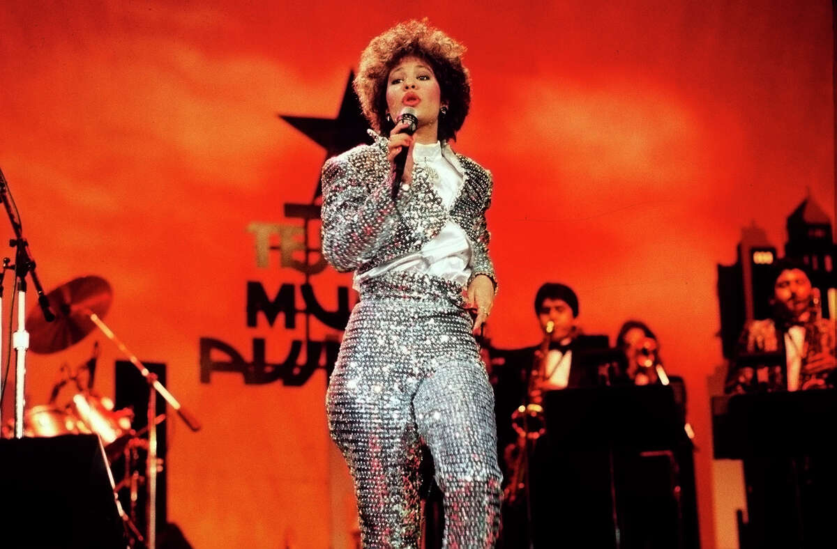 SELENA QUINTANILLA, female vocalist of the Year for 1987, singing on stage during the Seventh Annual Tejano Music Awards (3/23/87). PHOTO BY PHILIP BARR / EXPRESS-NEWS STAFF PHOTOGRAPHER --- CREDIT: EXPRESS-NEWS FILE PHOTO