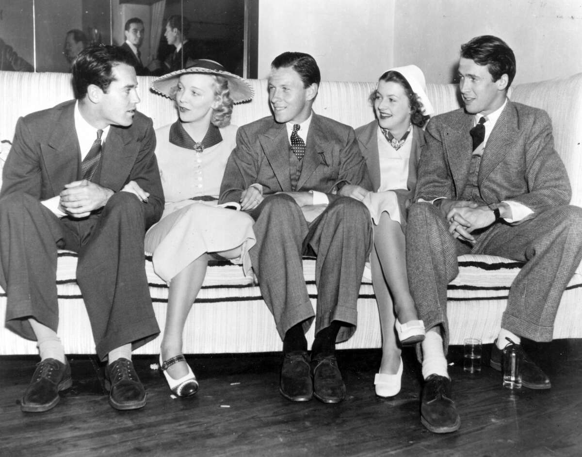 1930: Actor, dancer and politician George Murphy (1902-1992) with Henry Fonda, Virginia Bruce, Betty Furness and James Stewart (1908 - 1997) at the new West Side Tennis Club. (Photo by Hulton Archive/Getty Images)