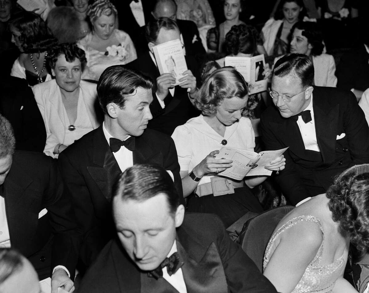 LOS ANGELES,CA - CIRCA 1939: Actor Jimmy Stewart sits with actress Margaret Sullivan during the movie premiere of The Shop Around the Corner