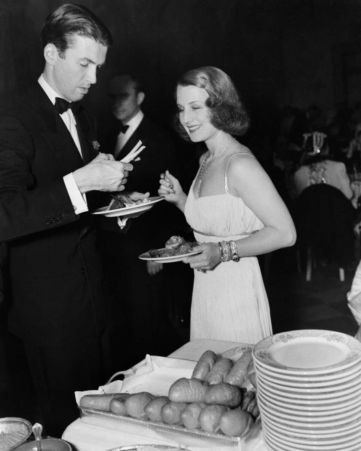LOS ANGELES,CA - CIRCA 1939: Actor Jimmy Stewart with actress Norma Shearer during an event in Los Angeles, California. (Photo by William Grimes/Michael Ochs Archives/Getty Images)