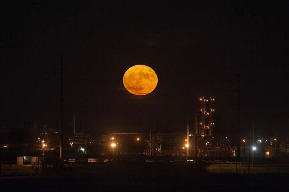 The moon rises over Midland Cogeneration Venture Monday evening. When a full moon makes its closest pass to Earth in its orbit it, appears up to 14 percent bigger and 30 percent brighter, making it a supermoon. This monthÕs is especially ÔsuperÕ for two reasons: it is the only supermoon this year to be completely full, and it is the closest moon to Earth since 1948. The next supermoon will be in 2034. Photo: Brittney Lohmiller/Midland Daily News/Brittney Lohmiller