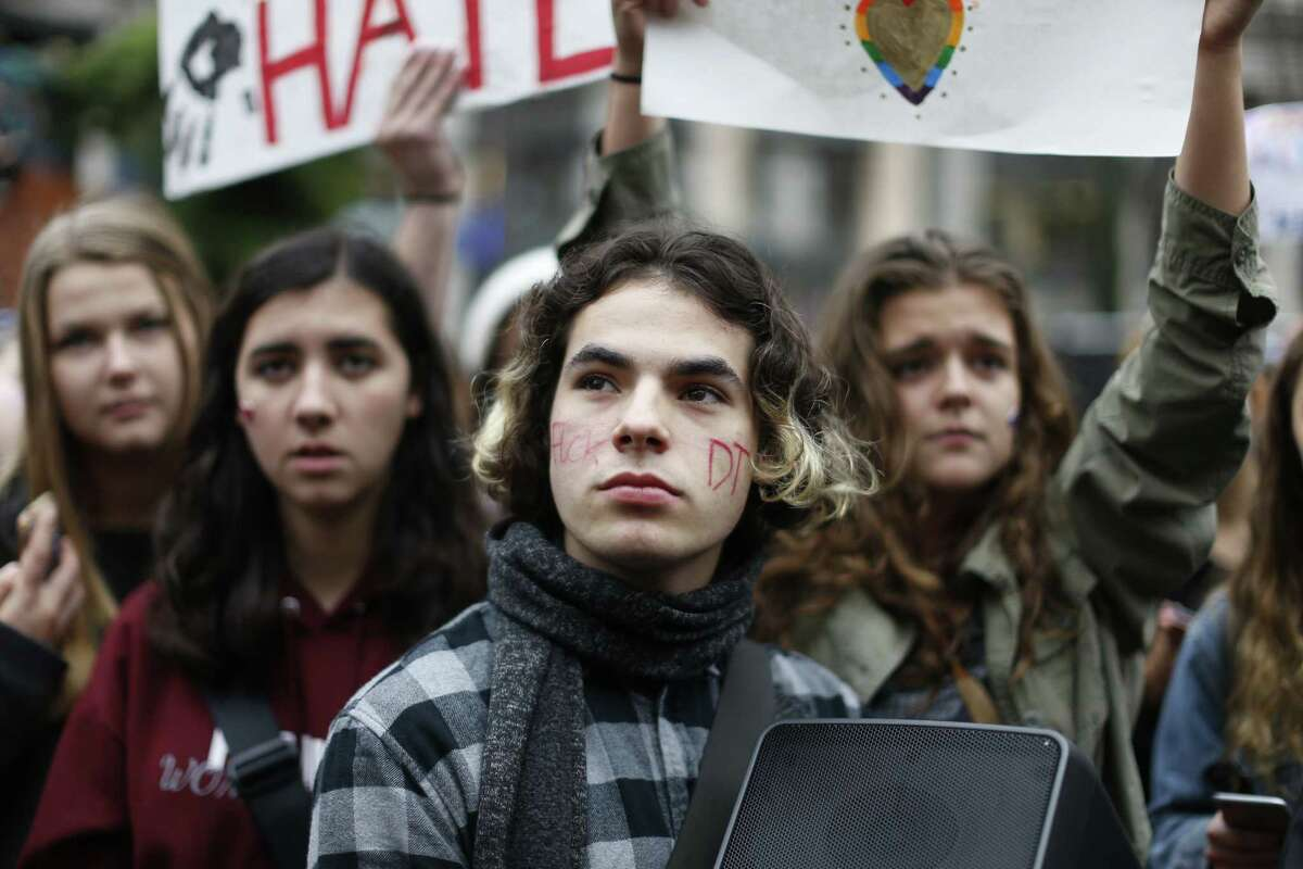 Portland Public School students walked out of schools Monday, Nov. 14, 2016, and converged on Pioneer Courthouse Square for a protest against the results of last week's presidential election. Hundreds of high school students joined protests in Portland on Monday against Donald Trump's election (Beth Nakamura/The Oregonian via AP)