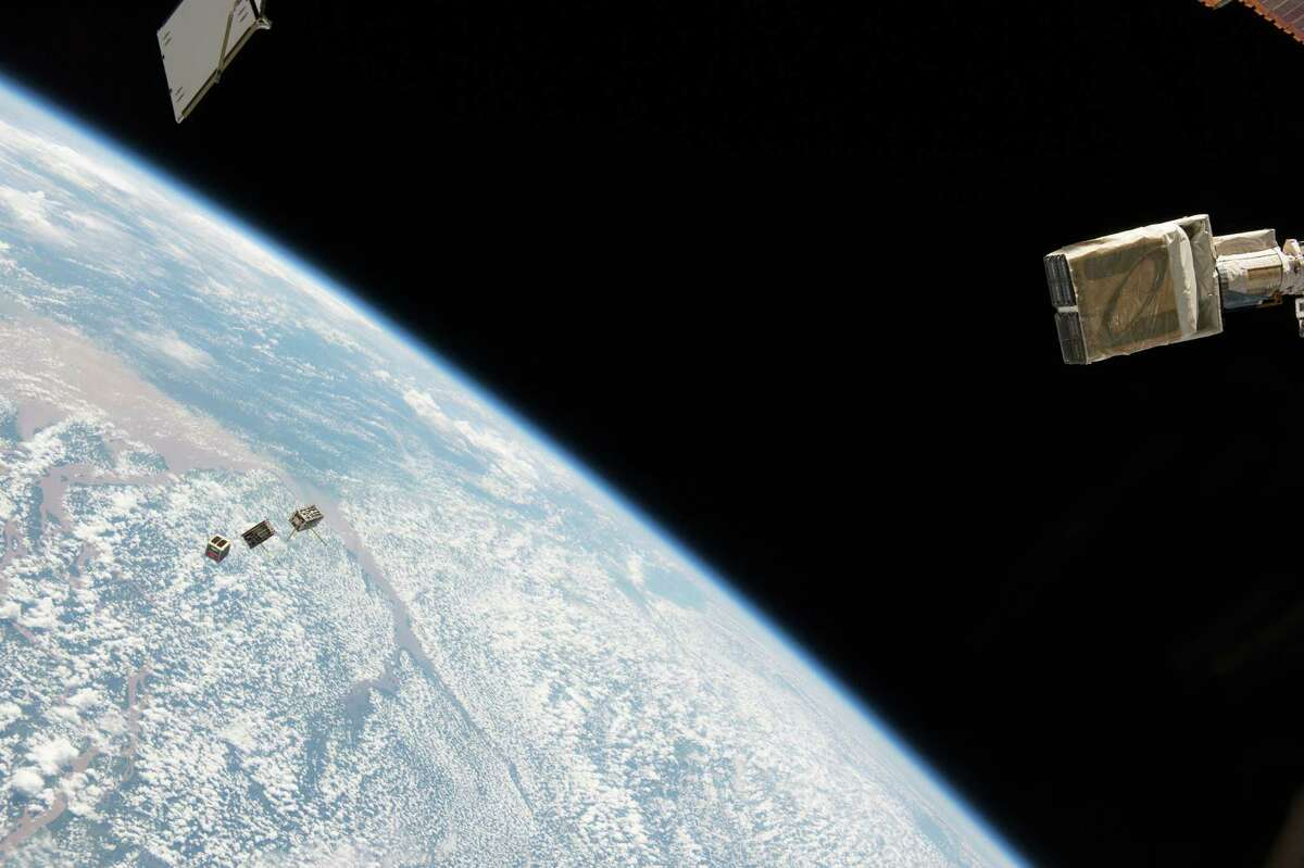 NanoRacks CubeSat Deployer is deploying three CubeSat satellites from the International Space Station. To date, NanoRacks has deployed 135 satellites from this system.