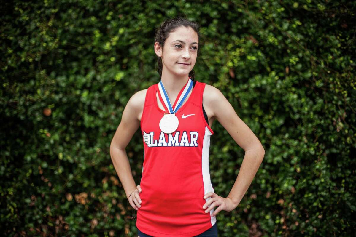 Julia Heymach, a junior at Lamar High School, poses for a portrait at the school Monday Decemeber 21, 2015. Heymach won the 6A state championship in girls cross country in November. (Michael Starghill, Jr.)