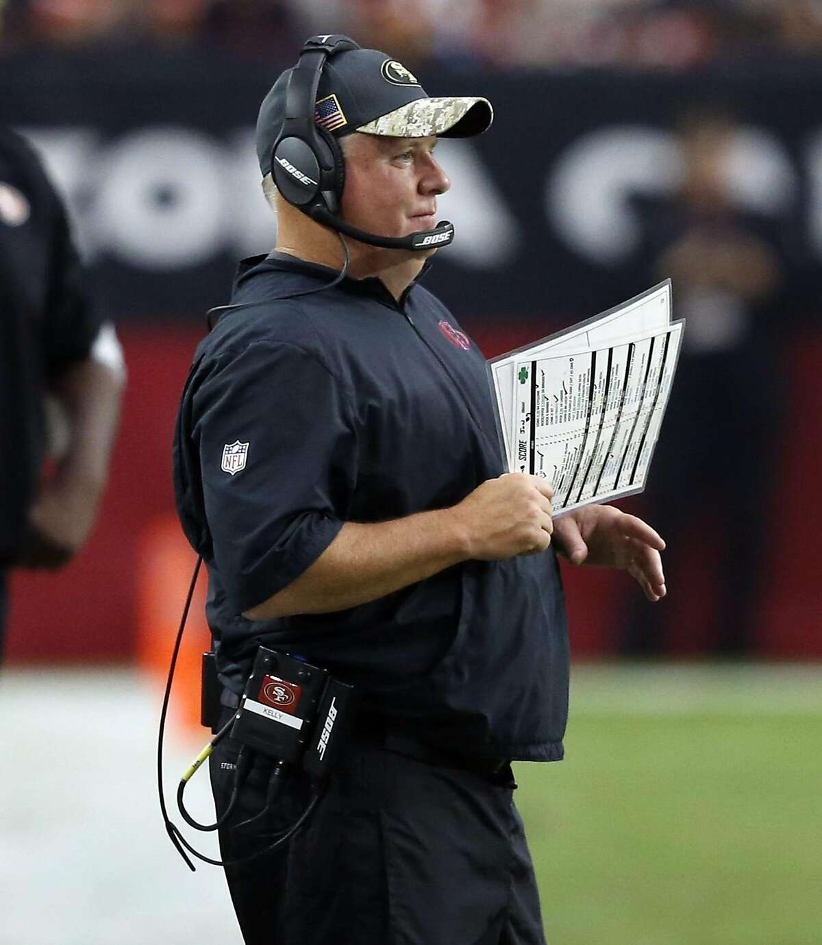 San Francisco 49ers head coach Chip Kelly watches during the first half of an NFL football game against the Arizona Cardinals, Sunday, Nov. 13, 2016, in Glendale, Ariz. (AP Photo/Ross D. Franklin)