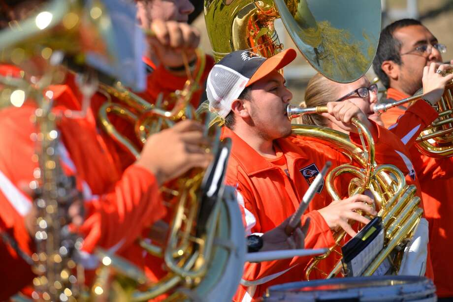 Kevin Munoz of the UTSA band plays his tuba during the ribbon cutting ceremonies for the recently completed $73.5 million Hausman Rd. expansion. Photo: Robin Jerstad, Freelance / San Antonio Express-News