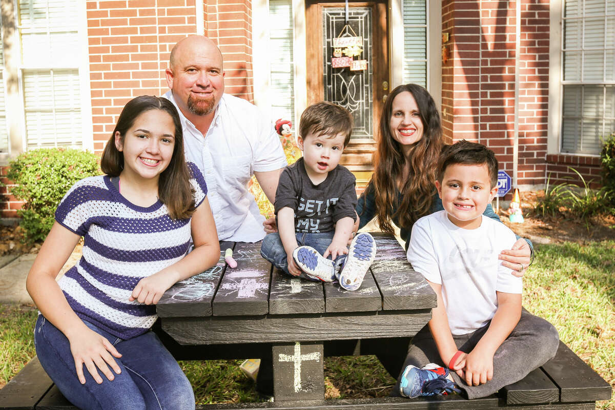 Dominic Larkin, who survived survived a drowning incident after three months at Memorial Hermann Children's Hospital in Houston, is pictured with his siblings Austin and Lyndy, and his parents Melissa and James, on Sunday, Nov. 13, 2016, outside of the Larkin household in The Woodlands.