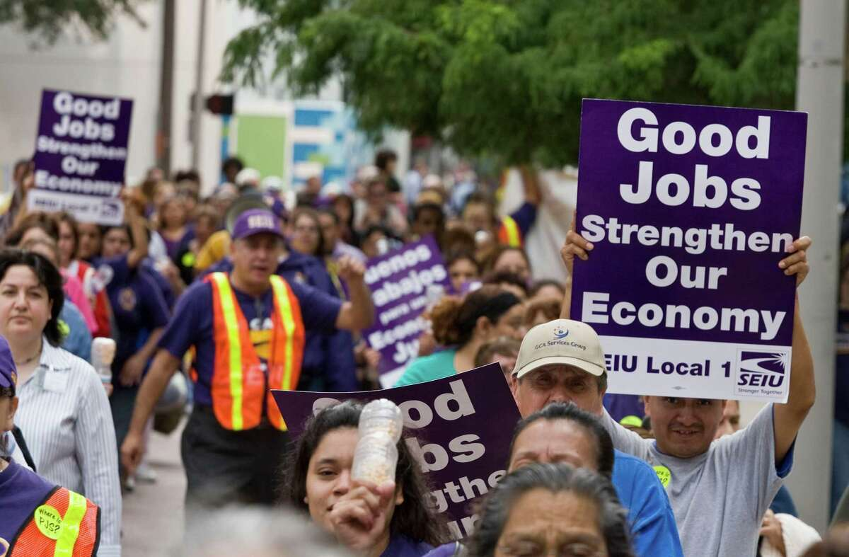 A rally and march by members of SEIU (Service Employees International Union) along Louisiana Street Wednesday, Oct. 28, 2009, in Houston. ( James Nielsen / Chronicle )