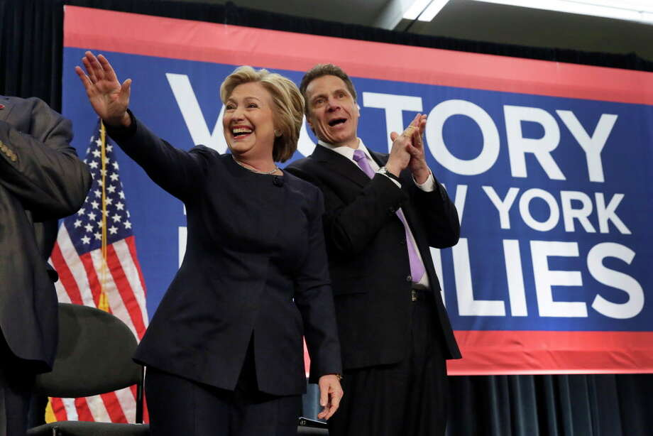 Democratic presidential candidate Hillary Clinton and New York Gov. Andrew Cuomo acknowledge the crowd as they are introduced at the Javits Convention Center in New York, Monday, April 4, 2016. The election of Donald Trump is leading some observers to suggest Cuomo as a formidable candidate for president in 2020. (Photo by Spencer Platt/Getty Images) Photo: Richard Drew / AP