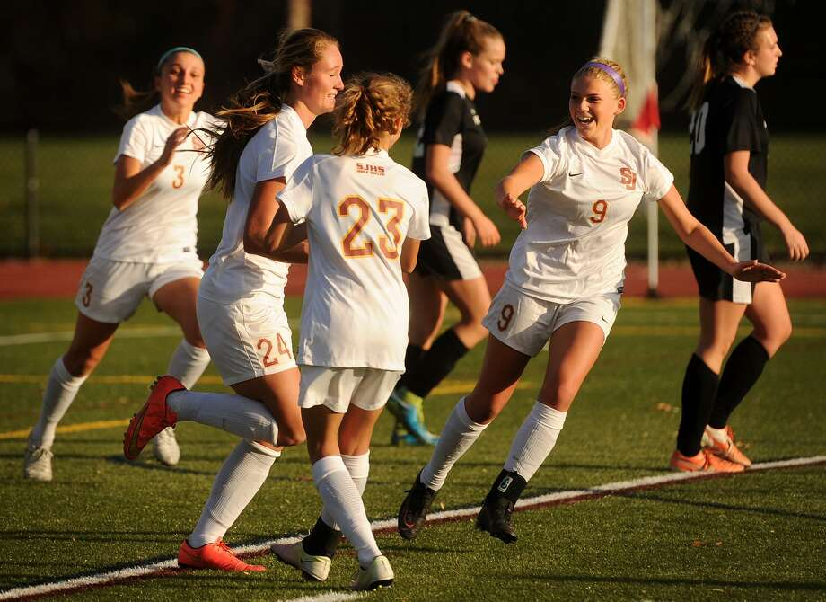 St. Joseph teammates celebrate a goal by Lindsey Savko, second from left, during their team's 4-0 victory over Pomperaug in the Class L state soccer tournament at St. Joseph High School in Trumbull, Conn. on Monday, November 14, 2016. Photo: Brian A. Pounds / Hearst Connecticut Media / Connecticut Post