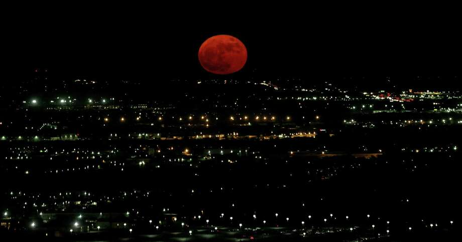 A nearly-full Supermoon rises Monday Nov. 14, 2016. According to NASA this Supermoon is the closest to Earth since 1948. The next Supermoon this close will be Nov. 25, 2034.  According to the Old Farmer's Almanac the Native American Algonquin tribes called November's full moon the Beaver Moon, because it was the time to set beaver traps before swamps froze. Photo: Edward A. Ornelas, San Antonio Express-News / © 2016 San Antonio Express-News