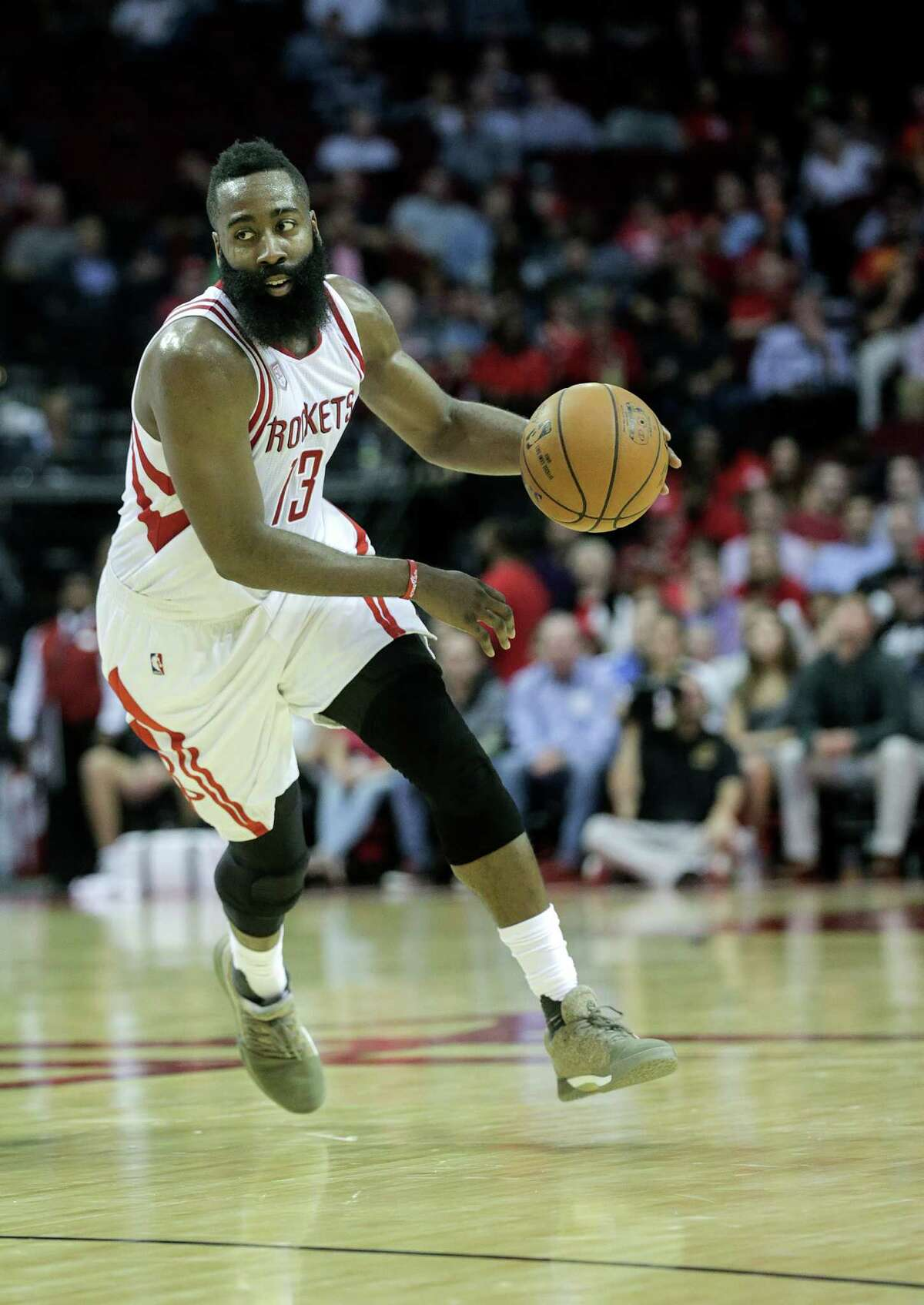 Houston Rockets guard James Harden (13) drives the ball up court during NBA game action against Philadelphia 76ers at the Toyota Center on Monday, Nov. 14, 2016, in Houston.