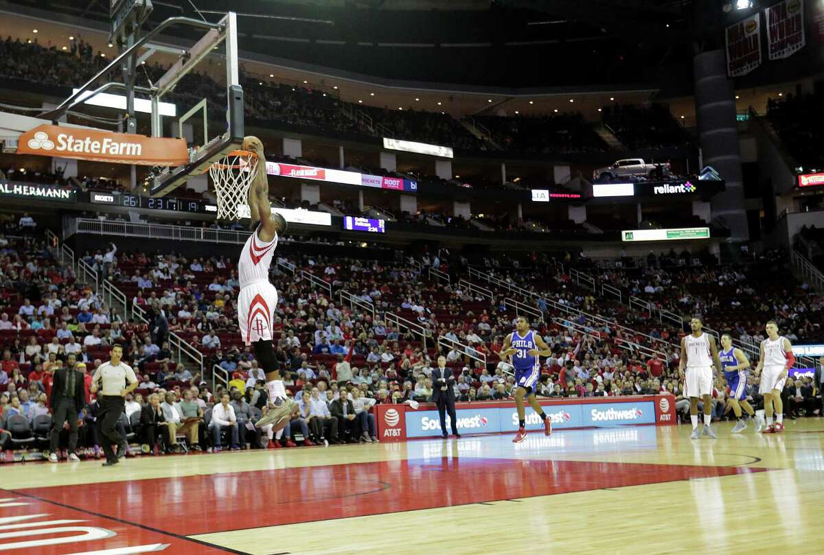 Houston Rockets guard James Harden (13) dunks the ball during a breakaway steal against the Philadelphia 76ers at the Toyota Center on Monday, Nov. 14, 2016, in Houston.