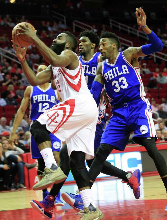 Houston Rockets guard James Harden (13) drives past Philadelphia 76ers defense in the first half of NBA game action between Houston Rockets and 76ers at the Toyota Center on Monday, Nov. 14, 2016, in Houston. Photo: Elizabeth Conley, Houston Chronicle / © 2016 Houston Chronicle