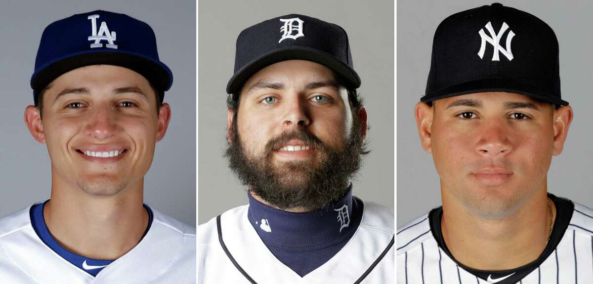 FILE - From left are 2016 file photos showing Los Angeles Dodgers' Corey Seager, Detroit Tigers' Michael Fulmer and New York Yankees' Gary Sanchez. Corey Seager of the Los Angeles Dodgers is the favorite in the NL, while Michael Fulmer of Detroit and Gary Sanchez of the New York Yankees are top contenders in the AL when the Rookie of the Year awards are announced Monday night, Nov. 14, 2016. (AP Photo/File)