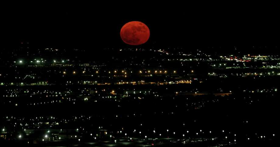 A nearly-full Supermoon is pictured from Tower of the Americas looking toward northeast Monday Nov. 14, 2016. According to NASA this Supermoon is the closest to Earth since 1948. The next Supermoon this close will be Nov. 25, 2034. According to the Old Farmer's Almanac the Native American Algonquin tribes called November's full moon the Beaver Moon, because it was the time to set beaver traps before swamps froze. Photo: Edward A. Ornelas /San Antonio Express-News / © 2016 San Antonio Express-News