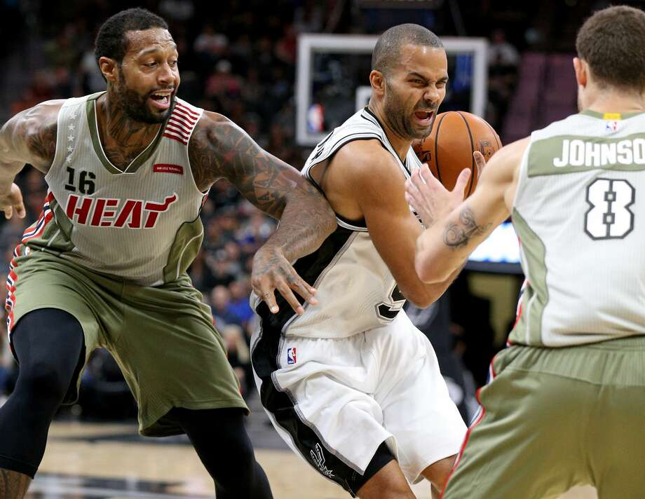 San Antonio Spurs' Tony Parker looks for room between Miami HeatÕs James Johnson (left) and Tyler Johnson during first half action Monday Nov. 14, 2016 at the AT&T Center. Photo: Edward A. Ornelas/San Antonio Express-News