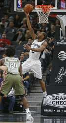 San Antonio Spurs guard Kawhi Leonard (2) shoots in front of Miami Heat Forward Justise Winslow(20) during the first half of an NBA basketball game on Monday, Nov. 14, 2016, in San Antonio. (AP Photo/Ronald Cortes)