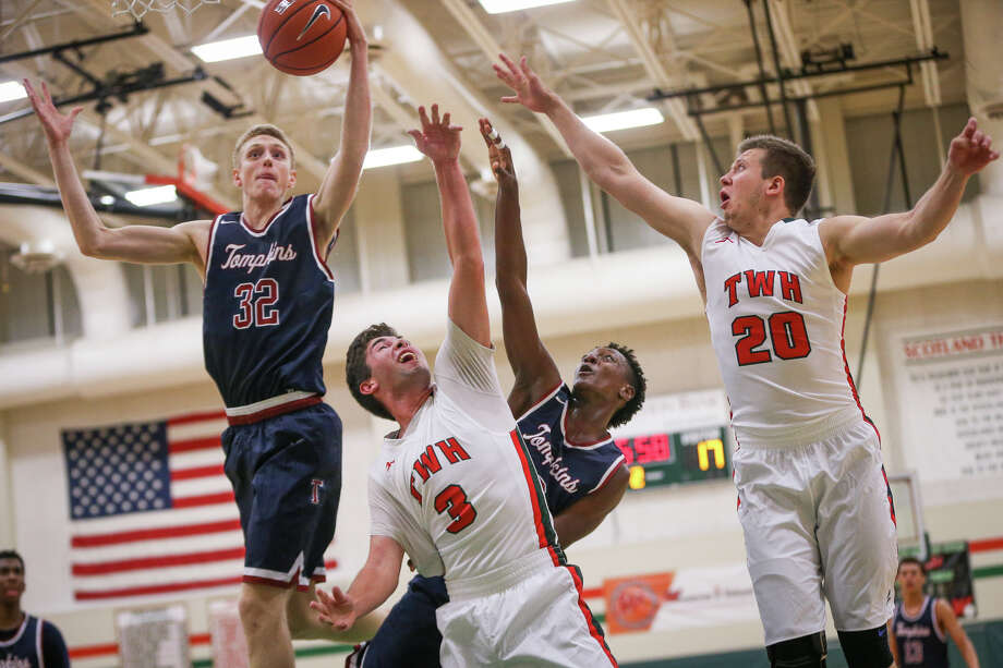 Tompkins' Kristian Sjolund (32) wins the rebound over Alex Tchouangwa (3) and The Woodlands' James Primavera (3) and Billy Phenicie (20) during the varsity boys basketball game on Monday, Nov. 14, 2016, at The Woodlands High School. (Michael Minasi / Chronicle) Photo: Michael Minasi, Staff / © 2016 Houston Chronicle