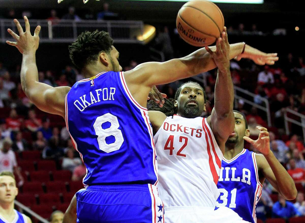 Houston Rockets center Nene Hilario (42) is stopped by Philadelphia 76ers center Jahlil Okafor (8) as he drives to the basket in the first half of NBA game action at the Toyota Center on Monday, Nov. 14, 2016, in Houston. ( Elizabeth Conley / Houston Chronicle )