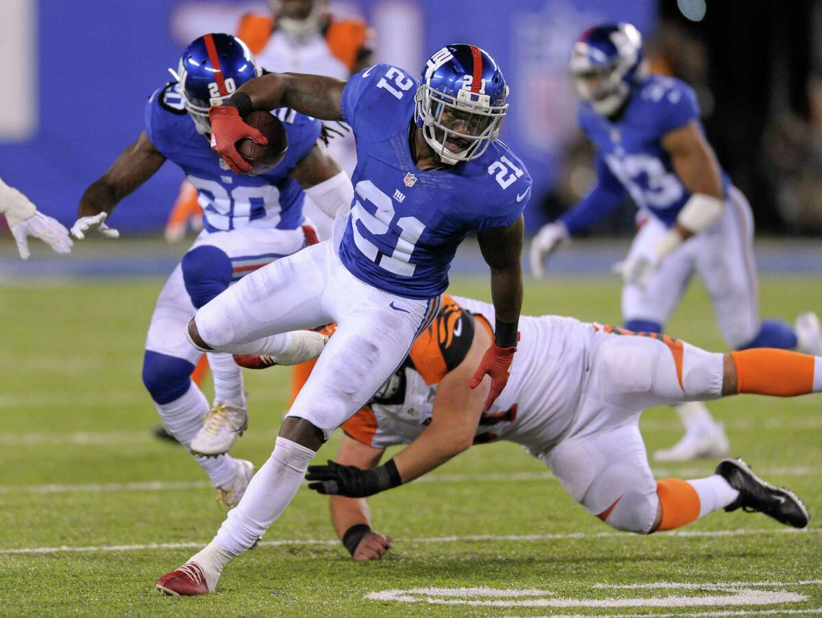 New York Giants strong safety Landon Collins (21) takes the ball up field after intercepting a pass from the Cincinnati Bengals during the fourth quarter of an NFL football game, Monday, Nov. 14, 2016, in East Rutherford, N.J. (AP Photo/Bill Kostroun) ORG XMIT: ERU136