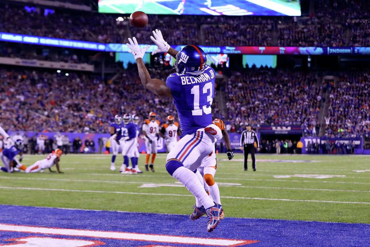 EAST RUTHERFORD, NJ - NOVEMBER 14: Odell Beckham Jr. #13 of the New York Giants catches a touchdown pass against the Cincinnati Bengals during the second quarter of the game at MetLife Stadium on November 14, 2016 in East Rutherford, New Jersey. (Photo by Al Bello/Getty Images) ORG XMIT: 663931509