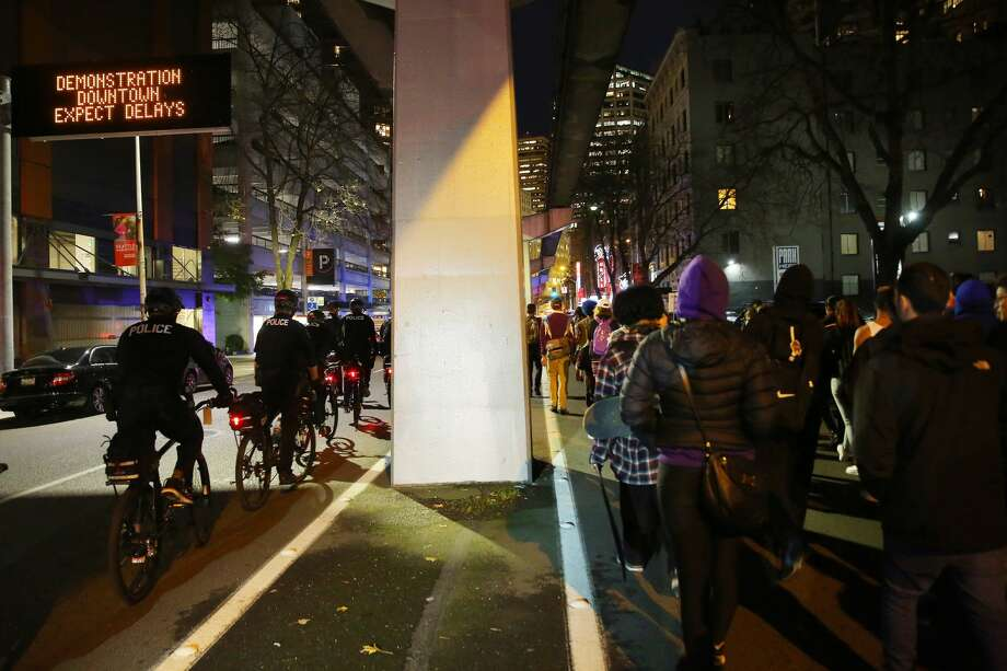 Demonstrators march through downtown Seattle on Monday evening to protest the President-elect Donald Trump. Three people were arrested during the largely peaceful protest; two have since been released. Photo: GENNA MARTIN/SEATTLEPI.COM