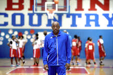 West Brook head coach Andre Boutte takes in the varsity practice, offering tips on strategy as the team runs plays Monday. Boutte was brought on as head coach during the offseason and looks to bring his successful coaching history to the Bruins. West Brook faces Ozen, which Boutte led to a state title in 2001, during tonight's season opener. Photo taken Monday, November 14, 2016 Kim Brent/The Enterprise