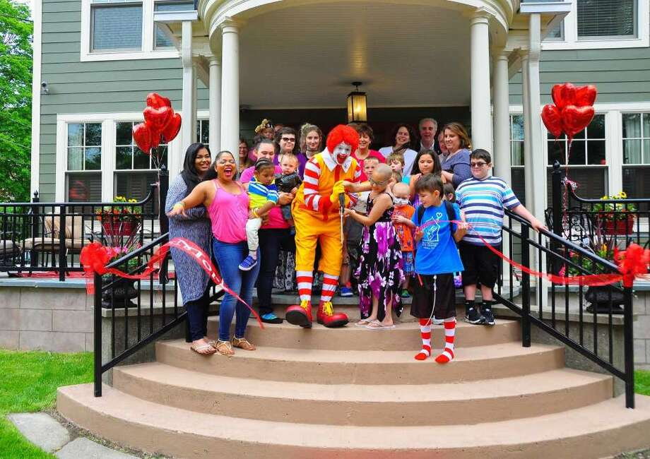 Ronald McDonald and children cut the ribbon to officially open the new Ronald McDonald House of the Capital Region at 141 S. Lake Ave. in Albany on June 27, 2015. (Steve Barnes / Times Union)