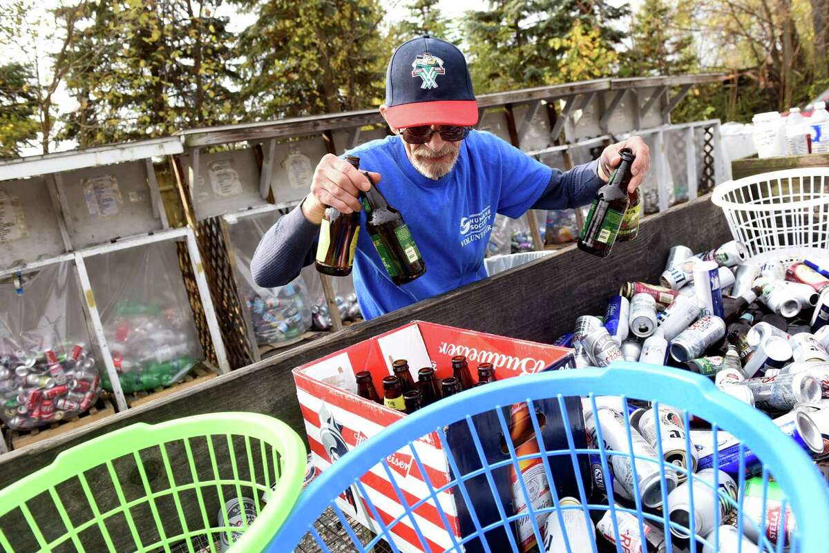 Paul Cooke, a volunteer with the Empties for Animals program, sorts bottles to redeem for cash on Wednesday, Nov 2, 2016, at the Mohawk Hudson Humane Society in Watervliet, N.Y. (Cindy Schultz / Times Union)