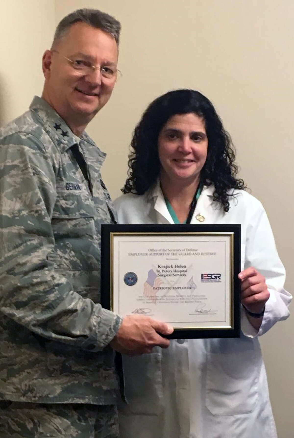 Major General Anthony P. German, commander of the New York Air National Guard, presents Helen Krajick, manager of the operating room at St. Peter's Hospital, with the Patriot Award in recognition of her support of Captain Donna McCormick, a nurse and an employee in the U.S. Armed Forces. (submitted photo)