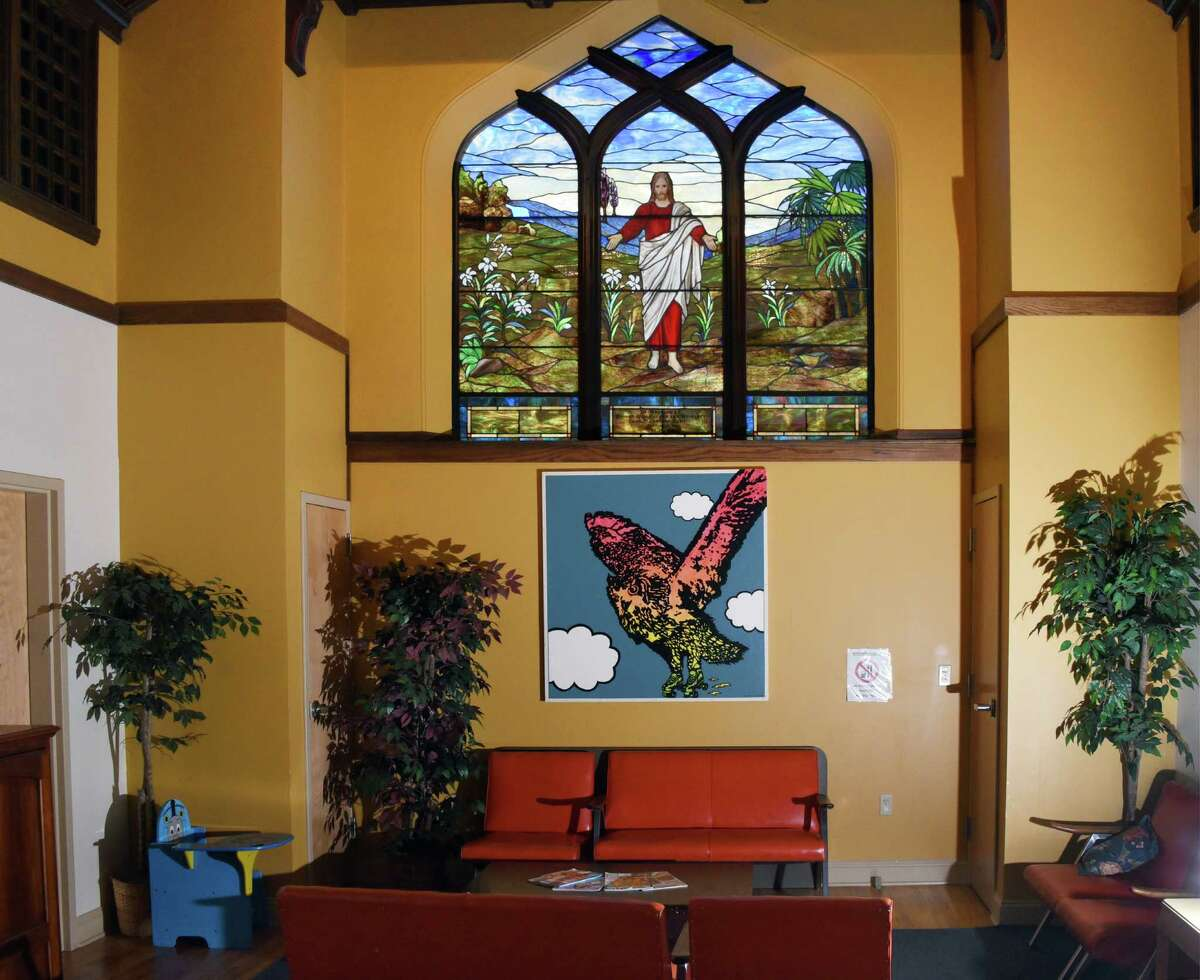 A large stained glass window in one of the living rooms at St. Paul's Center Wednesday Oct. 19, 2016 in Rensselaer, NY. (John Carl D'Annibale / Times Union)
