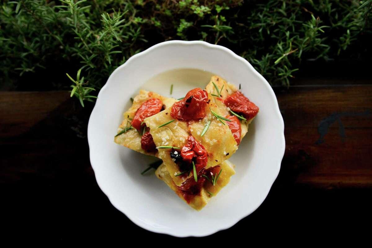 Focaccia with semi-secco tomatoes, sea salt and Sicilian olive oil at Arthur Ave, Thursday, November 10, 2016.
